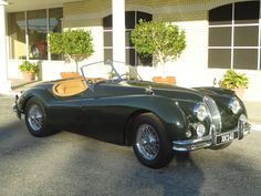 The ultimate dream car.  1955 Jaguar convertible British racing green