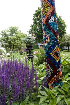mosaic pole is a fabulous idea! or on a stump...using weather proof tile and adhesive