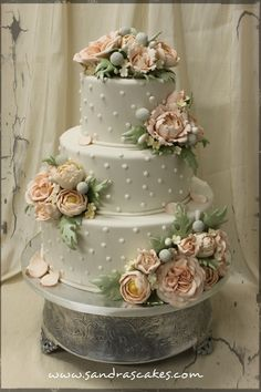 Wedding Cake make everthing silver and white with lillies instead of roses...  and all butter cream flowers.