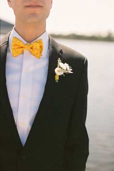 A yellow bow-tie makes for the perfect accent on a groom.