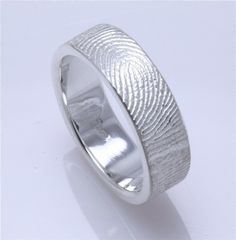 Fingerprint wedding ring. The couple molds their fingerprints on to each other's rings so they never lack the other's touch. ↑This is soooooo cool! ↑