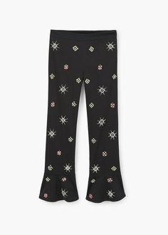 Spodnie flare z aplikacjami z koralików | MANGO