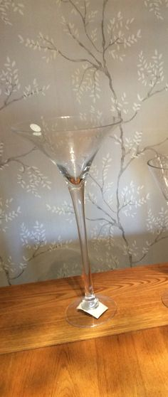Large tall 50cm Martini glass centrepieces for hire wedding events parties . Look striking with flowers real or artificial, gel beads, floating candles,feathers,fairy lights, beads,pearls twigs  We have 10 available for hire at £8 each