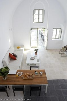 Love the view down through the living area Dining area living open plan stone floor full height Villa Fabrica Santorini Interior Architecture, Interior And Exterior, Interior Design, Greece House, Holiday Apartments, Luxury Accommodation, Inspired Homes, Sweet Home, House Design