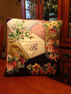 Right style cushion. Wrong initial (or floral embroidery)