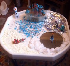 Frozen themed tuff tray with glitter cloud dough snow and water beads ❄️