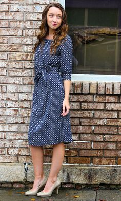 Womens bubble sleeve diamond print midi dress with matching ribbon belt available in navy and white
