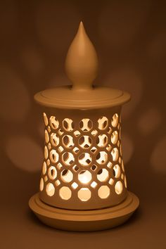Three Piece Minaret Lantern by Lynne Meade. Wheel thrown, hand pierced porcelain lantern or candle holder. Available in white matte or metallic gold glaze. Please note that this vessel is intended to be used only with LED candles.