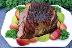 This ham has the best glaze recipe. It's sticky, sweet, tangy and penetrates the meat while roasting. Besides a roasting pan, you don't need any fancy gadgets to make this baked ham. Try this Blue Ribbon recipe. Best Baked Ham Recipe, Best Pork Chop Recipe, Pork Chop Recipes, Ham Recipes, Crockpot Recipes, Cooking Recipes, Recipies, Whole Ham, Cooked Pineapple