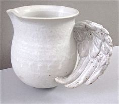 Ceramic pitcher with angel wing