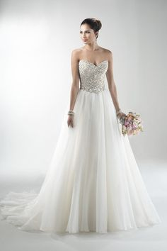 Embellished bodice with a tulle skirt by @maggiesottero - stunning wedding gown!