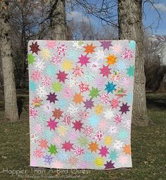 Sparkle Punch | Happier Than A Bird Quilts - background is Bella Solids Zen Grey - includes link to quilt tutorial