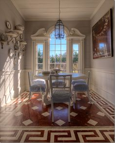 dining room with painted floor, blue and white ticking and interesting window