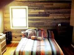 Our DIY palette wall made from cedar fence boards and homemade vinegar stains