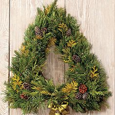 Festive Christmas Wreaths | Tree Form Wreath | SouthernLiving.com--This tree made of fresh greenery offers an alternative to the traditional round wreath without sacrificing fragrance. To shape your tree, trim the foliage using clippers.
