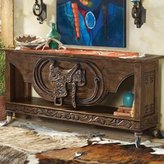 I have a flair for the Western/Southwestern decor.  This gorgeous and unique console comes from Crows Nest Trading.  Their catalogs take days for me to devour.  Very expensive but WOW … talk about eye candy.  LOVE IT!