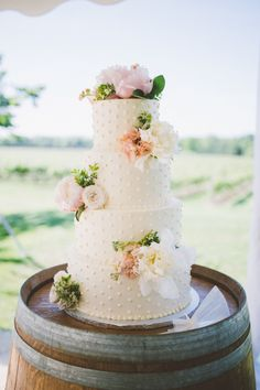 Floral accented wedding cake: http://www.stylemepretty.com/canada-weddings/ontario/niagara-on-the-lake-ontario/2015/11/27/elegant-orchard-summer-wedding/ | Photography: Nikki Mills - http://nikkimills.ca/
