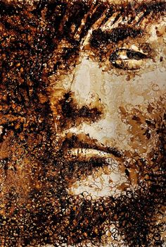 A portrait made with coffee stains from a coffee cup! The piece is by Red. She does her paintings using all but brushes and regular canvases. Really cool. Her blog here: http://www.ohiseered.com/