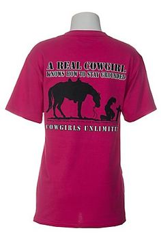 "Comfortable 100% cotton fucshia t-shirt. Screen printed cowgirl and horse kneeling at cross on back. Screen printed wording on back reads, ""A real cowgirl knows how to stay grounded"" and "" Every knee shall bow to me, and every tongue confess""-Romans 14:11. Large logo on bottom back. Small logo on front left chest. Machine washable. $17.00"