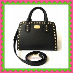 """Authentic Michael Kors Studded Leather Handbag % AUTHENTIC✨ Beautiful black leather studded handbag from Michael Kors Lightweight & very spacious. Length 10 1/4"""" Height 7 1/2"""" Width 6"""" with detachable & adjustable long strap. Very versatile. Crossbody, shoulder and top handle bag. Zipper top closure. 3 pockets inside, 1 outside back pocket. Yellow gold tone hardware. Feet on the bottom. STUNNING NO TRADE  Michael Kors Bags Satchels"""