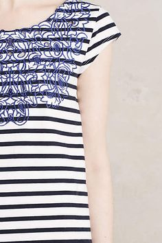 Like the combo of stripes with the overlay, makes the shirt very interesting.