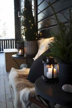 Winter porch// love the lanterns//