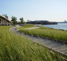 A new stairway in historic Riverside Park at 73rd Street leads the visitor south to an esplanade, sport field and pier whose café plaza connection to the park is also the social activity node. Description from worldlandscapearchitect.com. I searched for this on bing.com/images
