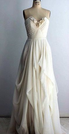 An absolutely stunning gown created with Silk Double Georgette. The cowls in this skirt are to die for!!! Only soft, flowy fabrics like Double Georgette or Chiffon could pull off a cowl skirt this well. Doesn't this gown just make you want to go run to your dress form and start draping? I know I sure do!