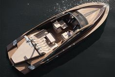 """This bespoke, 37ft cruiser is powered by dual, 370hp Yanmar diesel engines, which spin SS props for a top speed of 42 knots. There's plenty of high-end details as well, including a cockpit with room for eight, a multi-function table with a sunbathing area, tons of teak, a swimming platform, a small refrigerator, a built-in picnic box, Boxmark Maritime leather upholstery, and an air conditioned interior. Price unknown, but you know what they say: """"If you have to ask...."""""""