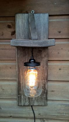 Lamp made of scaffolding wood and a preserving jar. Lamp, Candle Jars, Diy Outdoor Lighting, Lights, Jar Lights, Scaffolding Wood, Mason Jar Lamp, Minimal Decor, Industrial Decor Diy