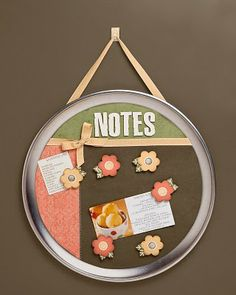 Turn a pizza pan into a memo board wall hanging. So clever!