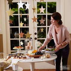 Create an Oscar-Worthy Setting:hang strung paper-glitter stars for a display as good as gold.