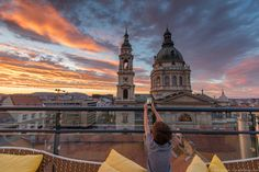 Things to do in Budapest with kids - Sunset over St. Stephen's Basilica from the rooftop terrace at the Aria Hotel Budapest