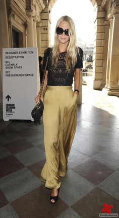 Poppy Delevigne - love the gold silk dress pants and black lacey top