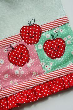happy apples on Livi's new tea towel