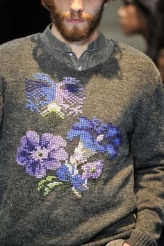 Man in cross stitch sweater....