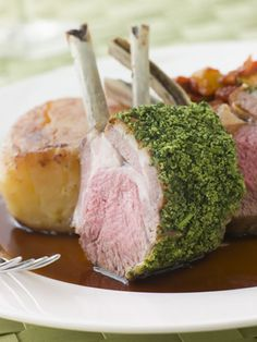 This gourmet dish might sound difficult but there is nothing hard about cooking an herb-crusted rack of lamb. Actually, it is pretty straightforward and you just need to brown the lamb, stick an herb crust on it, and roast it in the oven while you make a gravy on the stove. Lamb gravies vary, of course, but this one is made with red wine, rosemary and redcurrant jelly, giving it a sweet yet rich flavor.