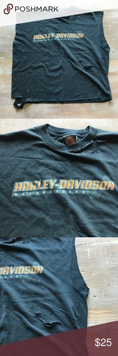 Official Harley-Davidson Cut Off Muscle Tee This tea is official Harley Davidson licensed product 100% cotton and a men's large. From a smoke free home. It has been cut to be shorter into a muscle T for a worn look Harley-Davidson Tops Muscle Tees