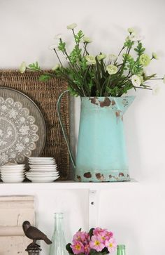 Shabby Chic | Old bottles and chippy, rusty old watering cans with flowers