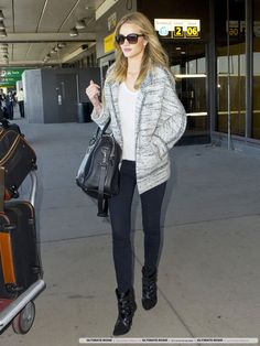 Rosie Huntington-Whiteley wearing Mulberry Albany Duffle Black Scotchgrain with Cognac Trim, Isabel Marant Tacy Suede and Calf Hair Ankle Boots, Balenciaga Voyage 24h in Noir Bag, Givenchy Square Tortoise Sunglasses, Isabel Marant Ioline Boiled Wool Jacket, Etoile Isabel Marant White Vincent Linen T Shirt, Mulberry Large Trolley Mole Scotchgrain with Cognac Trim, J Brand 811 Photo Ready Jeans in Blue Bird and Rimowa Silver Topas Multiwheel 78cm Suitcase.