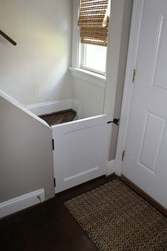 baby gate...door cut in half with traditional latch lock. $25 gate and so much cuter!  Clever