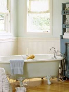 Love the breezy feel of this bathroom. Of course I can't resist a clawfoot tub.
