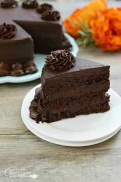 Ultimate Homemade Chocolate Cake is THE BEST CHOCOLATE CAKE EVER! It is so moist and tastes just like the chocolate tower from the Cheesecake Factory!