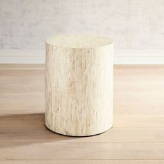 Elegant and modern, our mother-of-pearl accent table is a stunning eye-catcher. Its sleek lines let the lustrous strips of mother of pearl really shine. Place it anywhere you need a little inner glow.
