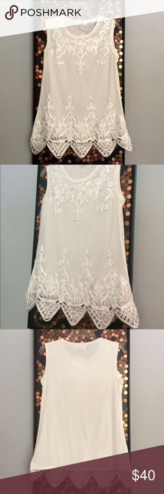 White Embellished Dress Tank. NWT Gorgeous polyester tank with a soft tooled, semi-sheet front. Ribbon and Faux pearls adorn front with a V-cut bottom. Size says L/XL, but I am that size with a D cup and the chest area was snug on me. Tops Tank Tops