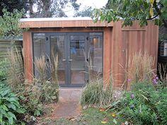 Garden studio for professional artist with hidden storage