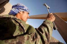An Afghan National Army engineer with 4th Kandak, 1st Brigade, 215th Corps, nails down a wooden beam during a reconstruction project here, June 11, 2012. The ANA engineers completed several projects earlier this month, including the establishment of Patrol Base Sistani and the turnover of PB Regi Topa from Marines and sailors of 2nd Battalion, 10th Marines, to ANA soldiers with the brigade's 2nd Kandak.