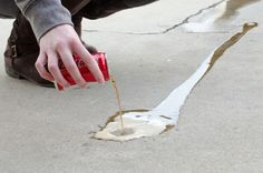 Remove oil stains on concrete. Pour cans of room-temperature cola onto concrete stains and let the soda sit overnight. Use old towels to blot the stain before rinsing off completely. Remove Oil From Concrete, Diy Concrete Stain, Concrete Cleaner, Clean Concrete, Concrete Lamp, Stained Concrete, Concrete Countertops, Concrete Floors, Cleaning Burnt Pans
