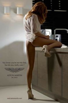 "In this Aston Martin ad, the woman is objectified in being compared to a luxury vehicle one can own. Her face is hidden, she is wearing very little, and is in a provocative stance. This along with the quote: ""you know you're not the first, but do you really care?"" make for a highly suggestive ad. This implies that while a man may not have been the first to own the car (have sex with the woman) he does not care because it (she) is so beautiful and the sensation of owning it (her) is…"