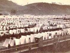 A view of prisoner of war camp that operated along the Chemung River in Elmira during the Civil War. Though more than 12,000 Confederate POWs were assigned to the Elmira prison camp, there was only enough barrack space for 5,000 prisoners